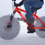 Ice-biker mods his cycle with buzz-saw wheels (crazy projects).
